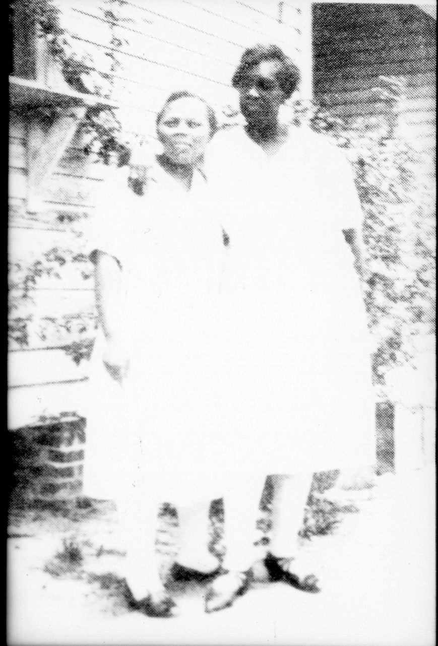 This photo (of the taller Black woman) is one of the only photographic images of Emma Booker.  Emma Booker founded the first Black school in Sarasota County.  Three schools are named after her, an elementary, middle, and a high school.  She came to Sarasota in 1910 at a time when education for Blacks was rare or non-existent.  She started Sarasota Grammar School.  She became its first principal and taught several classes.  She did not have a degree to teach, but continued to go to school-determined to finish college-and after going to school over almost 50 years finally earned her Bachelor's  degree.