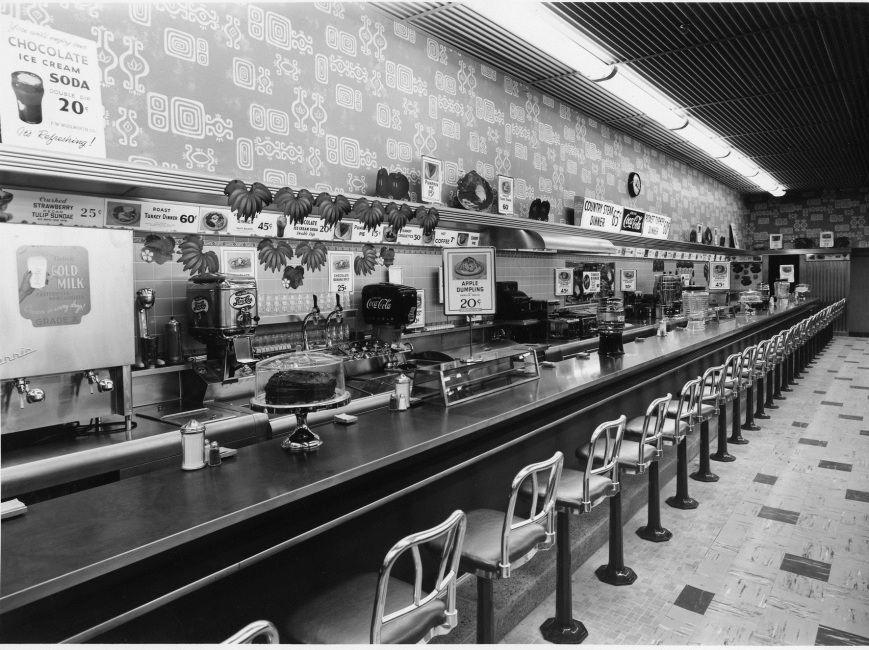 "This photograph is of the Woolworth lunch counter at the Ringling Shopping Center.  On March 2nd, 1960, a group of 11 African-Americans sat down here and were refused service.  The leader of the group, Gene Carnegie, is quoted as saying:  ""We could have easily brought 40 people in here and another 200 outside picketing, but that would incite trouble and would not be in the best interest of the Community"" –The modern Civil Rights Movement begins in earnest in Sarasota."